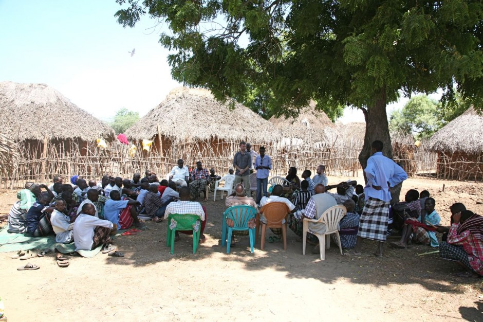 Chris gave a summary of Una Hakika to the community while John translated into Swahili.